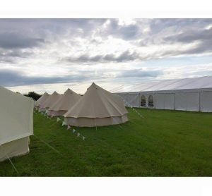 Marquees in field