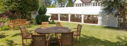 Table and Chairs Outside Marquee
