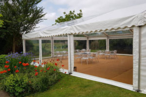 Clear Span Marquee Outside Through Flowers