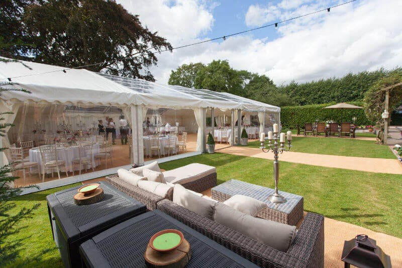 Marquee wedding with outdoor furniture