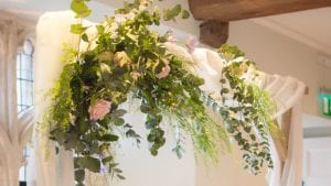 Flowers Over Wooden Arch